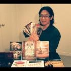 Dharma books and Buddha Shakyamuni pendant that H.E. Tsem Rinpoche sent to Canada for Jim Yeh.