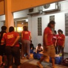 Erik Yeh and Jim Yeh volunteering at the Kechara Soup Kitchen food distribution in Malaysia.